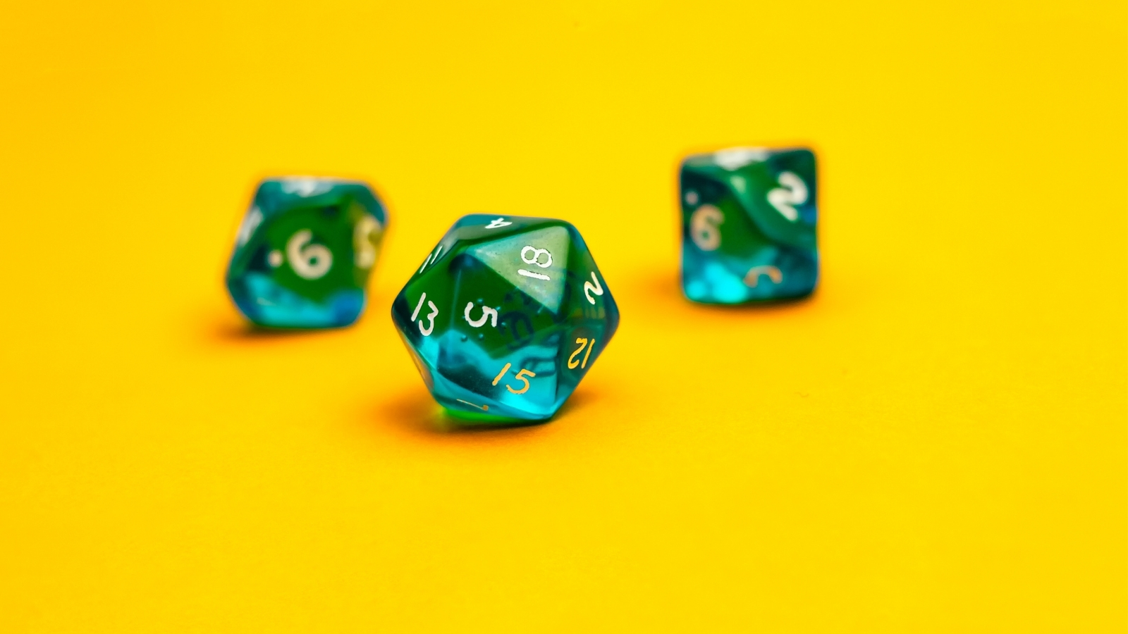 blue dice on yellow background